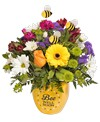 A 5in H yellow pot with 'Bee Well Soon' holds an all around arrangement with a rose, a mini gerbera daisy, alstroemeria, daisy poms, button poms, mini carnations, statice, bupleurum, and three bee stick ins. 13in H x 12in W; Overall 14in H with bee