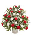 A classic one-sided triangular arrangement, suitable to be sent to a funeral or memorial service, with carnations and babies breath designed in a 9.5in  Pedestal Urn. 32in H x 29in W